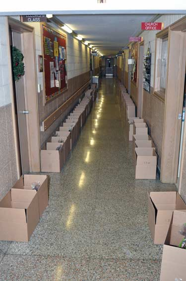 A Hallway Lined with Boxes