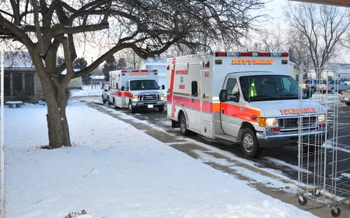 Two Ambulances Parked Along Curb